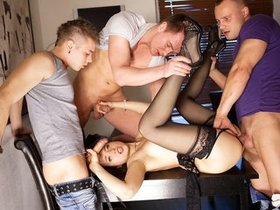 Hardcore gangbang for a sexy babe in stockings